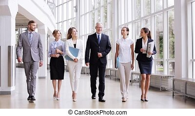 business people walking along office building 3 - people,...