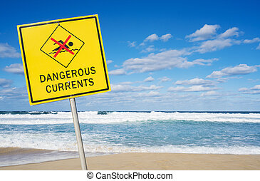 Dangerous currents sign on a beach - Dangerous currents sign...