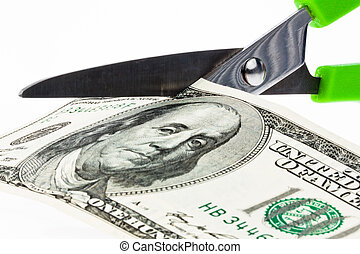 U.S. dollars bills and scissors