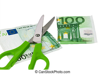 Euro banknotes and scissors - From ? a bill is cut with...