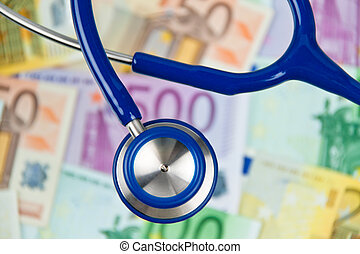 Many Euro bank notes with stethoscope. Health costs. - Many...