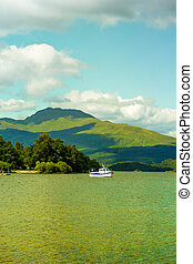 A boat on a sunny day at Loch Lomond lake in Scotland, UK -...