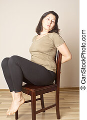 Middle aged woman doing yoga - Middle-aged asian woman on an...