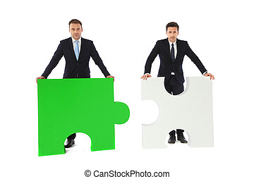 Business people with puzzle peices isolated on white...