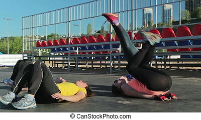 Fitness exercise - Leg Raise Drop. girls training together...