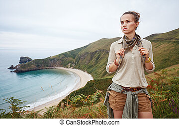 adventure woman hiker in front of ocean view landscape -...
