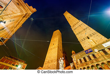 Ancient Asinelli Towers at night in Bologna, Italy.
