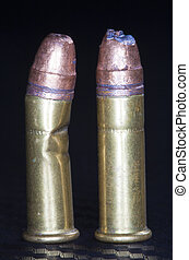 Damaged pair - Two rimfire round that have been damaged...