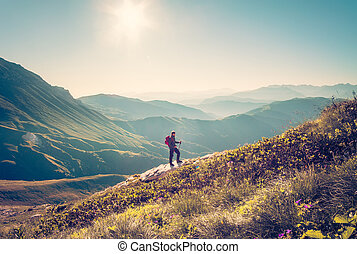 Traveler with backpack trekking - Man Traveler with backpack...