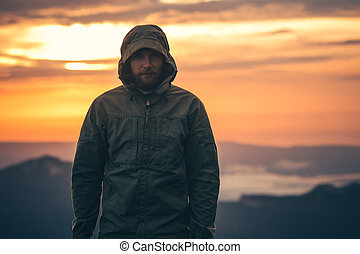 Man Traveler bearded standing alone outdoor with sunset...