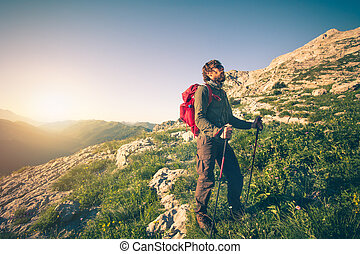 Young Man with backpack mountaineering outdoor Travel...