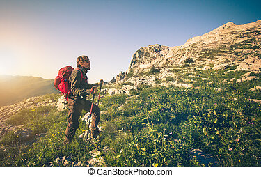 Man with backpack mountaineering - Young Man with backpack...