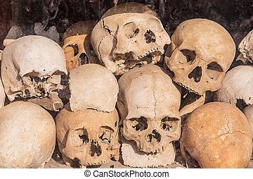 Pile of human skulls - Pile of human skulls on a wat thmei...