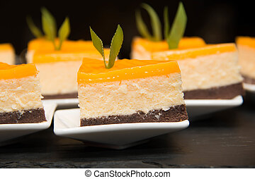 mini orang cheese cakes and slices decoration