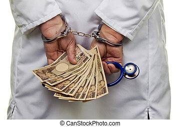 Doctor with Japanese YEN notes and handcuffs - A doctor with...