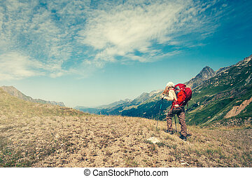 Woman with backpack mountaineering Travel Lifestyle concept...