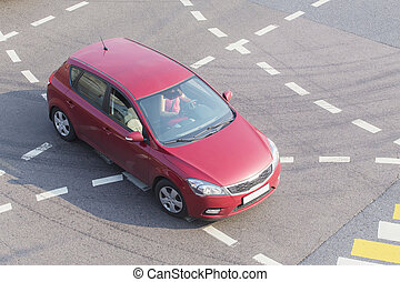 car at intersection with marking