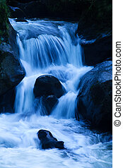 Creek with running water and stone (rock) - A creek with...