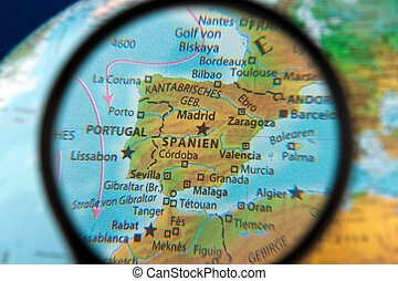 Spain viewed through the magnifying glass on a globe