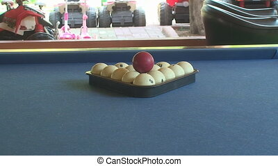 Slider shot of pool balls racked with cue ball ready - Pool...