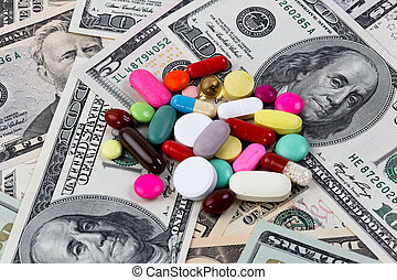 Costs of health, tablets and dollar bills