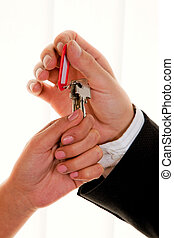 Real estate broker with a house key - Successful real estate...