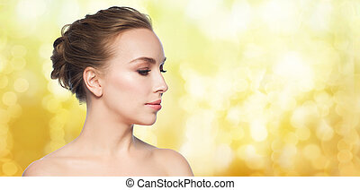 beautiful young woman face over white background - health,...