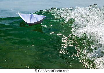 Paper boat struggling with a huge foamy waves - Paper boats...