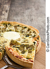 French quiche Lorraine with vegetables on a rustic wooden...