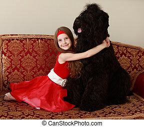Girl hugging a dog - Cute little girl with long brown hair...