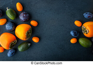 Assorted fruit on the dark stone table