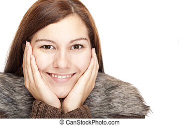 Closeup of a beautiful happy relaxed woman with hands on chin