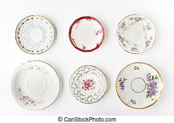 Set of vintage plates on the white background