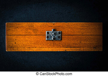 Wooden box on the dark stone table