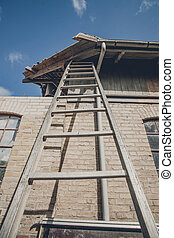 Tall ladder at an old building