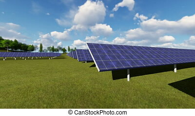 Solar panels on a green field on a background of blue sky...