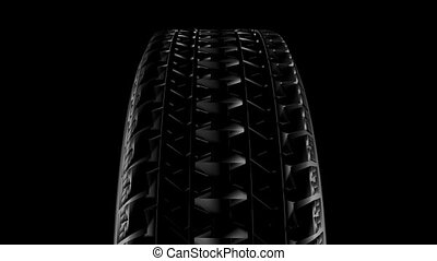 Close up on a car tire in motion. Seamless loop. HD...