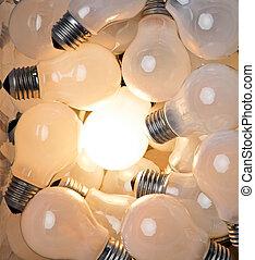 Many light bulbs, a light, a symbol for ideas