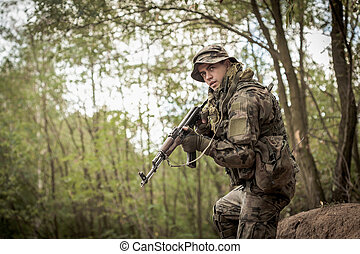 It is important to camouflage well - Shot of a soldier with...