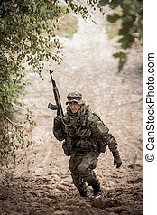 Ready for training hard - Shot of a soldier in camo, runnind...
