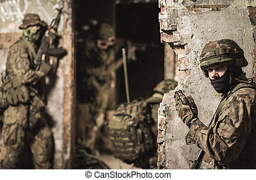Ready for the next task - Closer shot of a soldier standing...