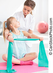 Exercising with physiotherapist