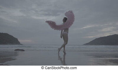 Beautiful angel woman with pink wings - Romantic young...