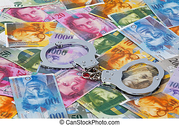 Handcuffs and Swiss franc