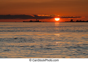 ship silhouette at sunset on Pacific ocean at Point Roberts,...