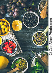 Concept of Mediterranean cuisine. Different fruit , herbs and appetizers on the  wooden table vertical