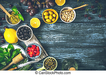 Concept of Mediterranean cuisine. Different fruit , herbs and appetizers on the wooden table