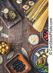 Ingredients of Italian cuisine on the wooden table vertical