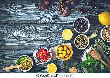 Concept of Mediterranean cuisine. Different fruit , herbs and appetizers on the blue wooden table