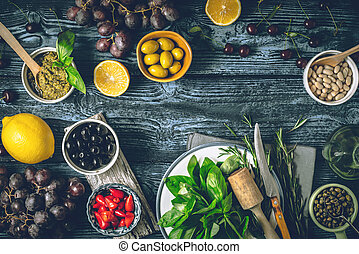 Concept of Mediterranean cuisine. Different fruit , herbs and appetizers on the wooden table horizontal